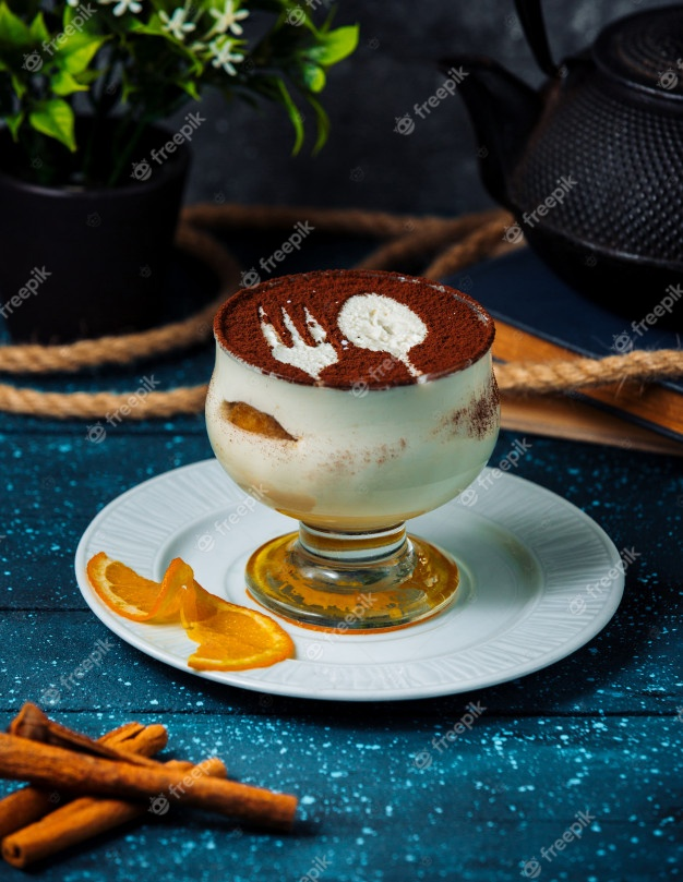 cup tiramisu with cocoa powder cinnamon sticks 114579 3567