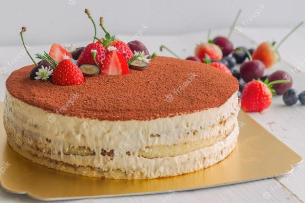 tiramisu cake sprinkle with cacao powder decorated with fresh fruits italian classic 54413 244